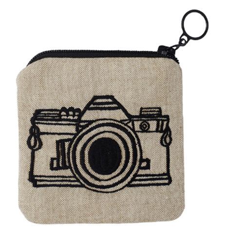 This cream colored bag with a black zipper shows the outline of a camera in black lines.