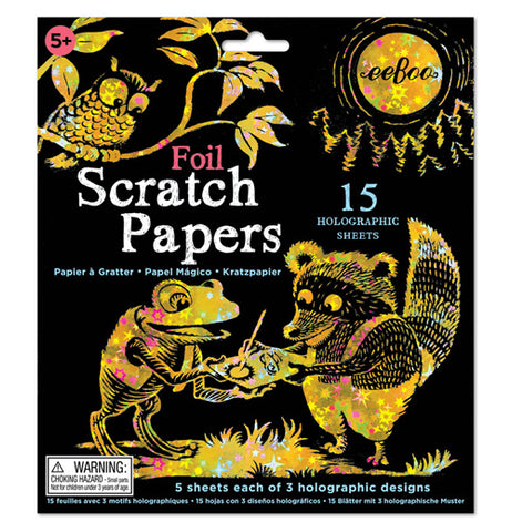 This book of foil scratch paper features a frog, an owl, and a raccoon in gold on the front with a black background and a gold moon.
