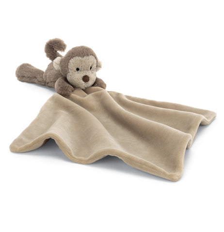 The baby blanket with the stuffed monkey attached is shown unfolded and open.