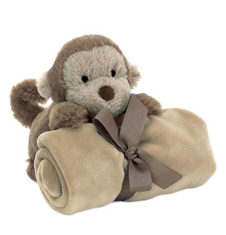 This baby blanket has a stuffed monkey attached to it. It is shown wrapped and tied up.