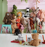 The grey stuffed kitten toy is shown sitting among some other stuffed animals.