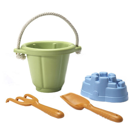 The Sand Play Set has a green bucket, a blue sand castle mold, a brown shovel, and a brown rake.
