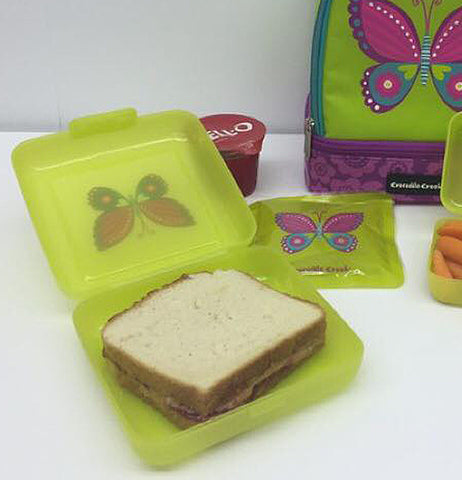 "The ""Butterfly"" sandwich keeper carries a sandwich inside with other accessories."