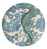 This dinner plate has a design of a dark green seahorse against a flowery oceanic background.