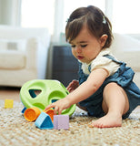 Baby playing with her shape sorter kids game with square, star, circle, and triangle shapes.