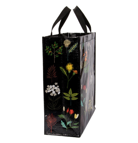 The side of the bag is shown here with some white and yellow flowers, some red leaves, and a few green bushes.