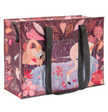 "The 'Flamingo"" Shoulder Tote Bag features flamingos holding red flowers in their beaks."