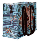 The blue bag with the red lotus against the water background on its front shows red damselflies against the watery background on its side.