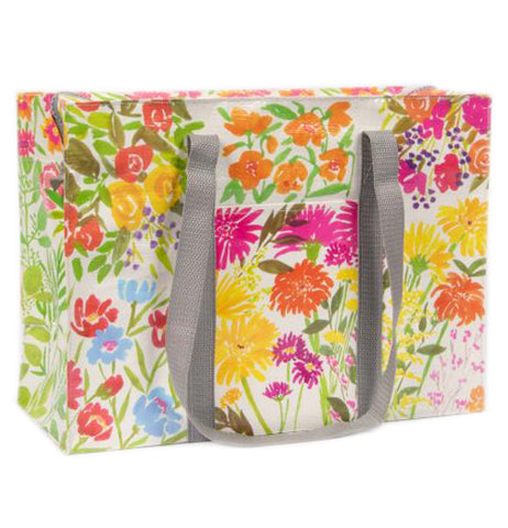 This white tote bag with gray handles is shown with a design of pink, orange, yellow, and periwinkle blue flowers.