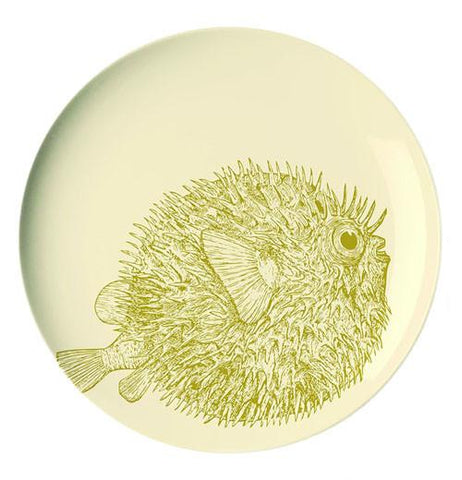 This cream colored plate has a picture of an olive green puffer fish.