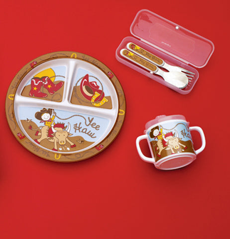 "The ""Yee Haw"" silverware set is shown next to a plate and cup with the same designs."