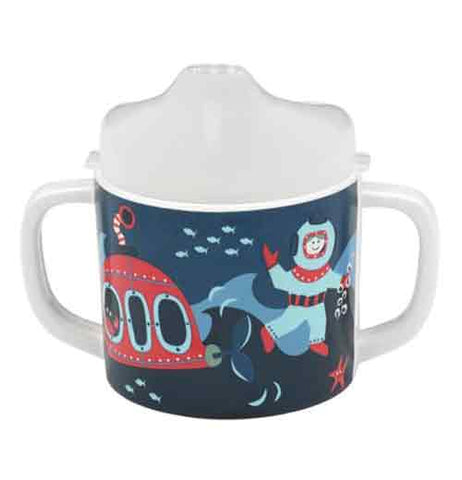 This sipping cup has an ocean design with a submersible, fish, and diver on it. It is blue with a white top and white handles.