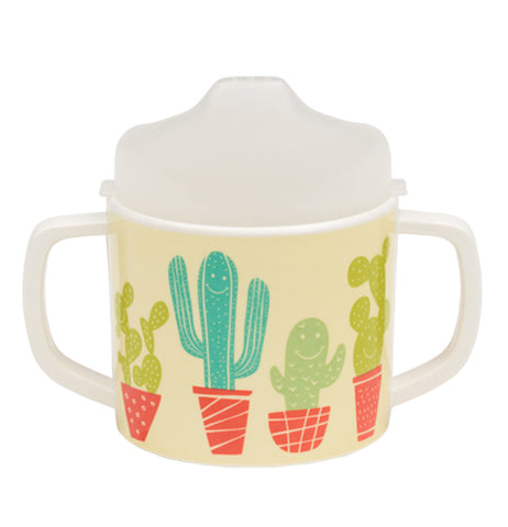 A light yellow sippy cup with a desert theme of potted cacti