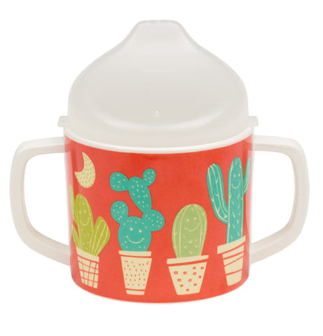 A reddish-orange sippy cup with a desert theme of potted cacti