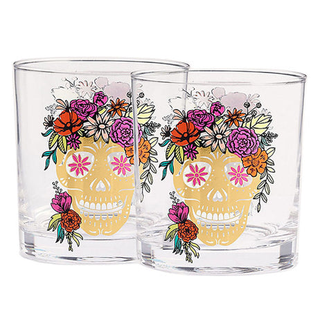 These 2 Skull Tumblers  have festive sugar skulls on each of them. The skulls have flowers on their heads and flowers for eyes.