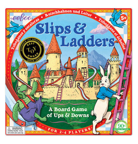 "The ""Slips & Ladders"" Board Game has the illustrative cover of the castle, along with the turtle on the left, and a rabbit on the right."