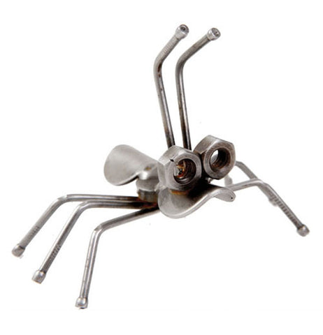 This small ant sculpture with six legs and two antennae is made of recycled metal.