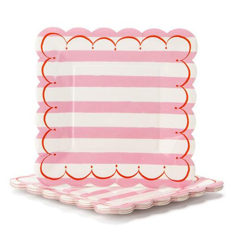 Plate that is white and pink stripped with pink and white scalloped edges.