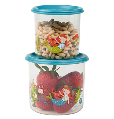 A two size set of semi-clear mermaid themed snack containers filled with cereal and strawberries