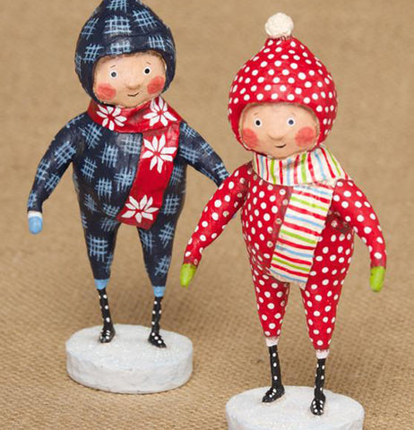 The blue and red outfitted snow suit figurines are shown standing together.