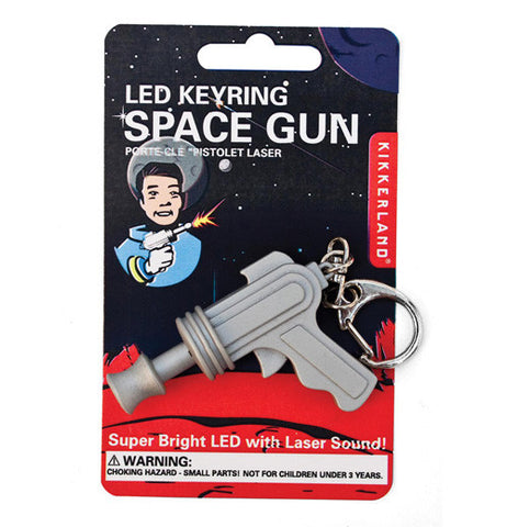 This is a led space gun key ring in package.