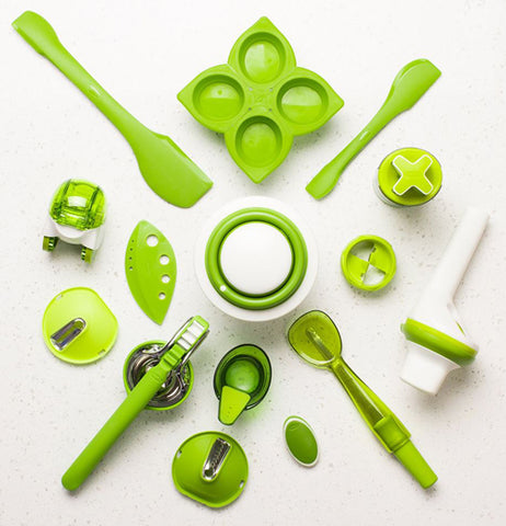 "The Slim ""Switchit"" Spatula is arranged in a circle with other green kitchen tools."