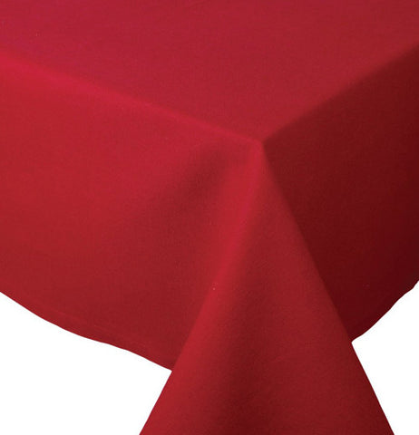This red tablecloth is shown folded at the end of the table.