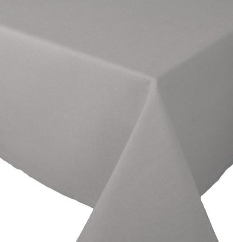 "The Rectangle ""Spectrum"" (60x90) Tablecloth is gray-colored and folded on the end of the table."