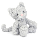 This stuffed toy is of a small grey kitten with a pink nose, and two black pellets for eyes.