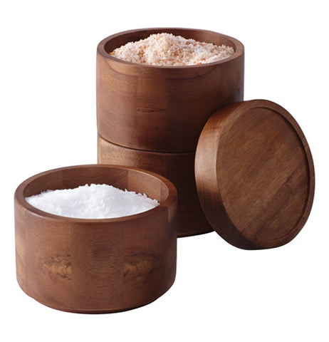 Set of 2 stacking round salt boxes showing seasonings inside the boxes.
