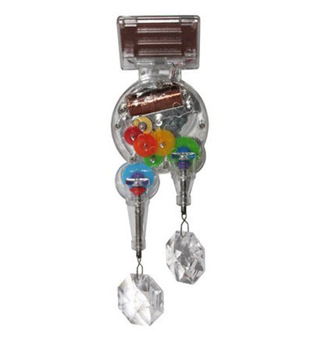 Two crystals hanging from a motor with brightly colored gears and a solar panel. all encased in a acrylic casing.