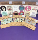 The dog sticker sheet is shown sitting on a purple table cloth to the left of some cat and llama sticker sheets.