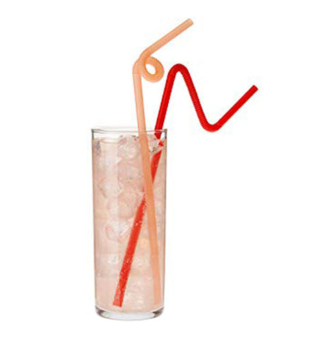 A glass full of beverage and ice is shown with an orange straw and red straw.