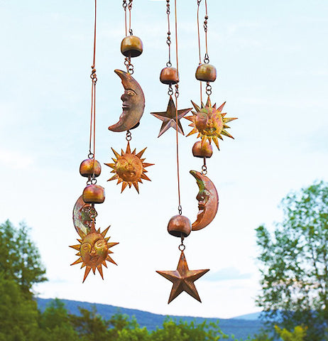 Sun, moon & stars connected to a mobile hanging outside.