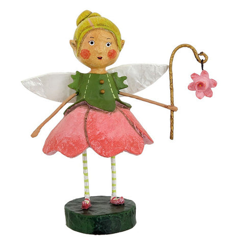 Kid dressed in a green vest and dark pink skirt with white wings with her yellow cap while holding a cane with a pink flower at the end.