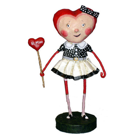 "Female figurine with heart shaped head holding a heart shaped wand with ""sweetheart"" printed on it"