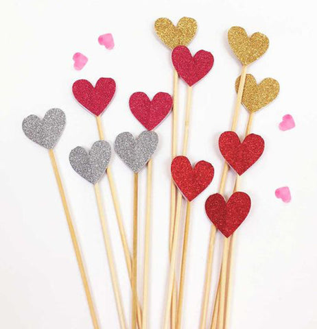 Swizzle sticks with embellished glittering hearts at the end.