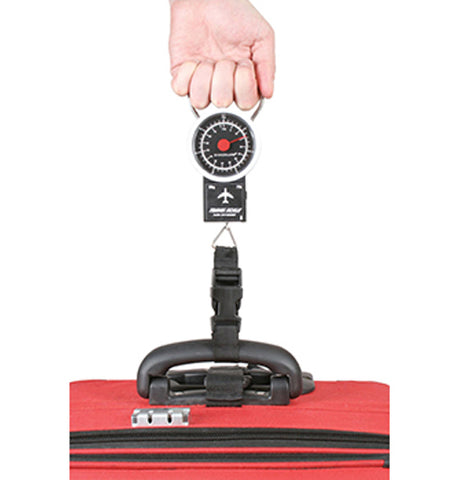 Travel luggage scale being used to weigh out the luggage before a flight.