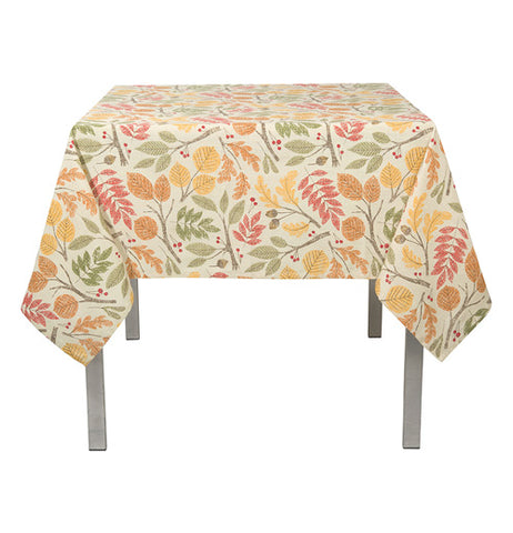 A tablecloth with a red, orange, green, and yellow leaf pattern.