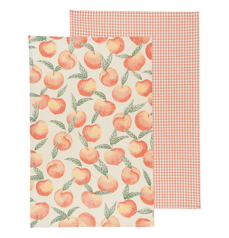 tropical colored Peaches on one towel and a red plaid design on the other.