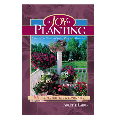 The purple book of the Joy of Planting has picture of colorful flowers in the garden area.