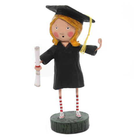 The figure of a female graduate with a diploma standing on a stand.