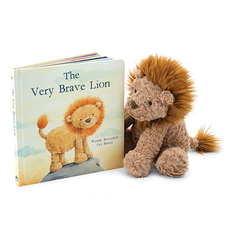 The Very Brave Lion book standing slightly open next to Fuddlewuddle stuffed lion.