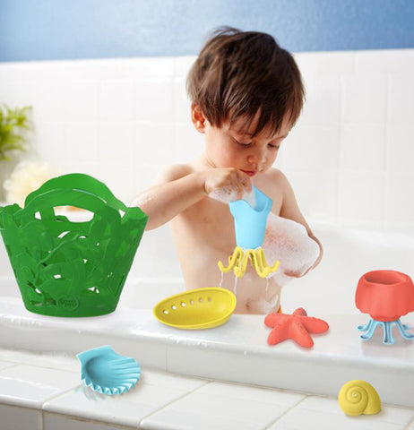 "The boy playing in the bath tab with one of the ""Tide Pool"" Bath Set pieces."