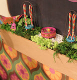 "Two of the (Mini) ""Tire Swing"" Garden Picks works well on the planter box with other miniatures."