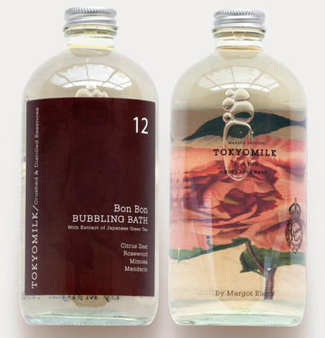 "The two sides of the bubble bath bottle are shown, with one side showing the pink rose, and the other showing the number 12 and the words, ""Bon Bon Bubbling Bath"" in white lettering against a brown background."