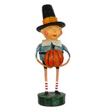 This figurine is named Tom, and wears blue pilgrim clothing with a black top hat. He also carries an orange pumpkin.
