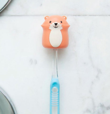 Fox shaped toothbrush holder attached in the shower.