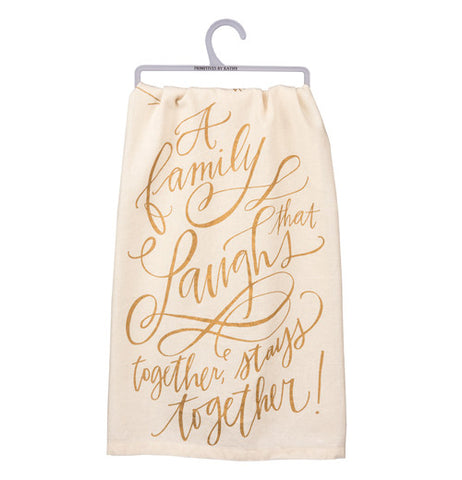 "Dish Towel ""A Family that Laughs Together Stays Together"" on it in gold print with an off white background."