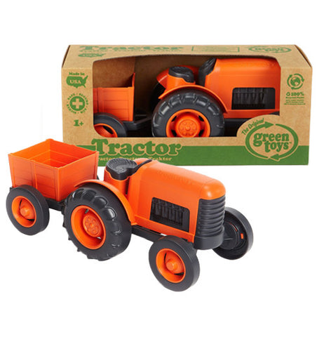 Orange and black six wheeled Tractor with trailer attached to it made from recycle materials with the package in front.
